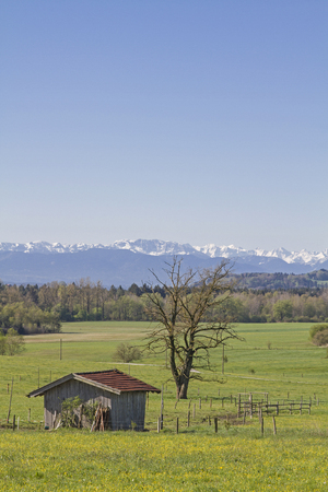 View of the Bavarian pre-Alps with the Benedictine wall and the Herzogstand, behind  the mighty Karwendel mountain ranges