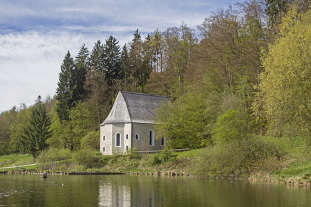 former: The former Sanctuary of St. Sebald in Egling is beautifully situated on a pond west of Egling Stock Photo