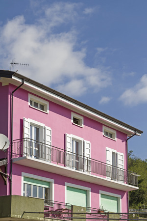 Pink colored dwelling house in Friuli, by its color a true eyecatcher