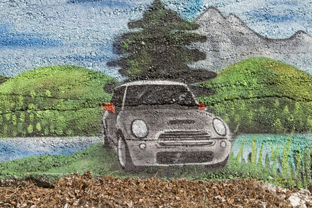 Color-heavy image on the concrete wall of a street border