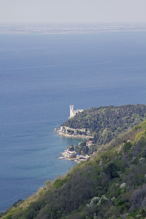 castello: View from the Napoleonica to Miramare castle that was built on a rocky cliff near Trieste in the 19th century
