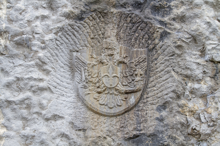 Historical coat of arms on a rock wall in the climbing garden Belvedere, which is part of an interesting climbing route