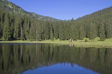The small idyllic lake Wildsee in the Ester mountains is rarely visited by hikers and mountain bikers