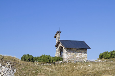 Small mountain chapel on the summit plateau of Monte Altissimo Stock Photo