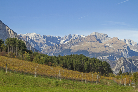 Autumn landscape in the Cavedine valley southwest of Trento in front of the peaks of the Brenta group