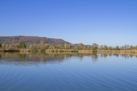 The Eichsee is an idyllic bog lake in the Kochel Moor in Upper Bavaria Stock Photo