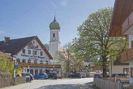 Church of St. Martin and the inn to the Post in Egling a small village in Upper Bavaria Editorial