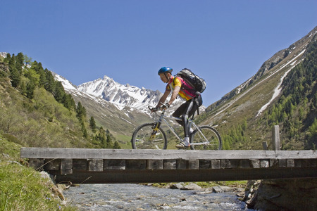 On a mountain bike tour through the Rein Valley in South Tyrol you pass this rustic wooden bridge