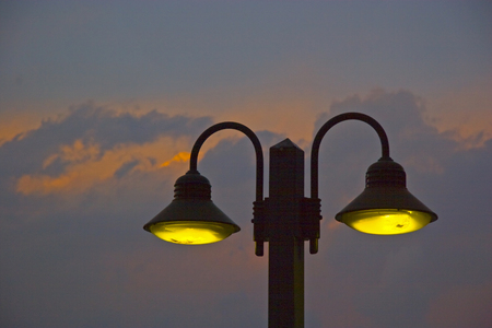 Street lighting at the beach promenade in Riva in the blue hour
