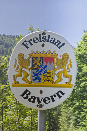 Border sign on the German-Austrian state border, which indicates the entry of the Free State of Bavaria Editorial