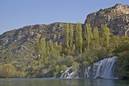 The river Krka flows through rough karst terrain and offers many natural wonders and attractions for its visitors