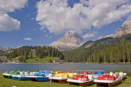 Colorful pedal boats on Lake Misurina against the backdrop of the mighty Drei Zinnen