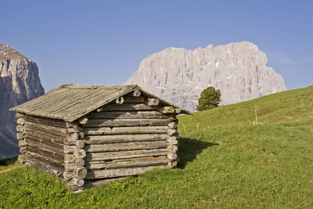 On the Gardena Pass - idyllic hay huts in block construction, the landscape of South Tyrol is indispensable