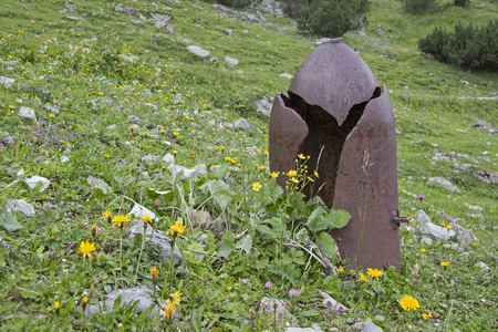 Remnants of warlike times - destroyed artillery projectile at 1600 meters altitude in the Lalider Valley in Tyrol