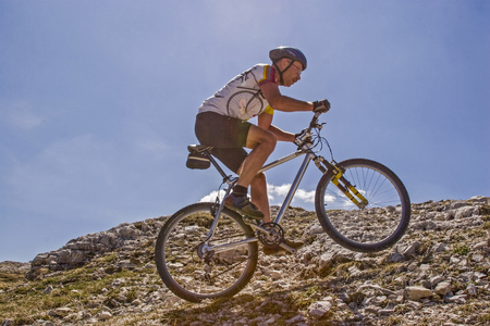Pure exertion - challenging uphill in the stone desert of the Dolomites
