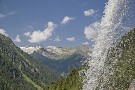 Free-falling waterfall in the beautiful mountains of the Zillertal Alps