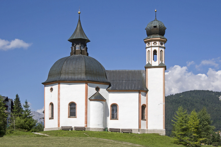 The lake chapel  Heilig Kreuz was built in baroque style and is a significant pilgrimage church