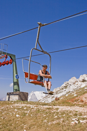 Mountain hikers relieved the strenuous mountain tour by using the chairlift Stock Photo