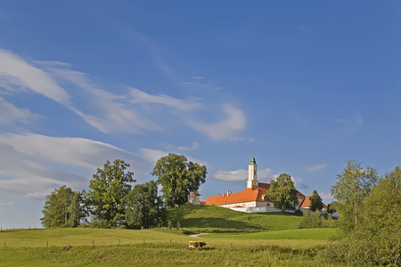 Reutberg - Upper Bavarian monastery with a well-known brewery is idyllically located near the small moor lake Kirchsee