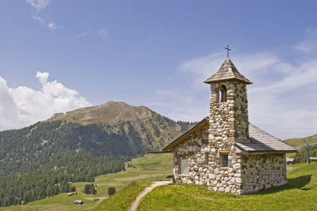 Small mountain chapel on a plateau in Val Gardena