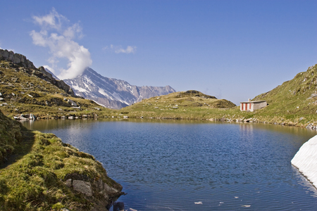 During the hike up the Pfitscher Joch in South Tyrol you can take a rest at this idyllic mountain lake Standard-Bild - 97711729