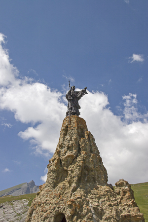 Statue of Saint Bernard, the patron saint of mountaineers on the mountain pass Petit Saint Bernard