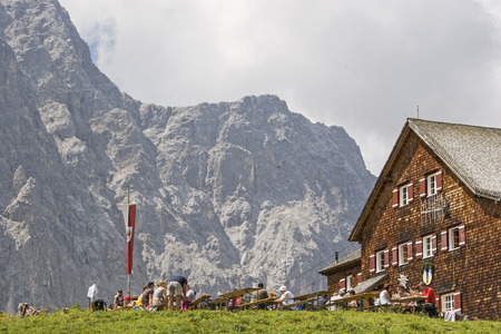The Falken Hut on the Spielissjoch in the Karwendelgebirge is built in front of the mighty walls of the Laliderer Editorial