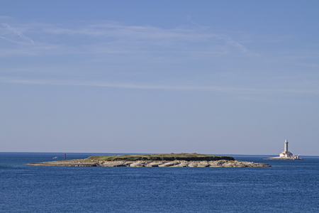 Lighthouse Porer on a small rocky island off the lonely southern tip of the Istrian peninsula