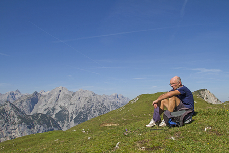Mountaineer has reached the highest point of the Satteljoch and enjoy the view