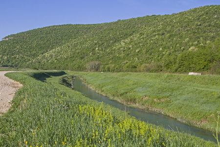 The small Istrian river Rasa meanders for many kilometers through a deserted and uninhabited valley Stock Photo