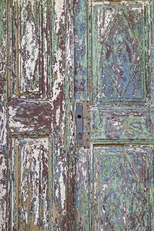 Background Image - Detail of an old door with peeling paint coating Stock Photo
