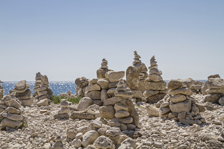 An army of stone towers gather here on the peninsula Zlatni rt on this idyllic stretch of coastline