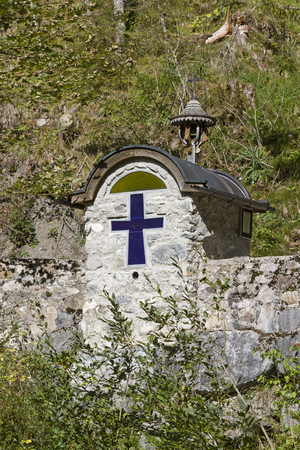 Chapel at the old Gaicht Pass Road, which leads from Weissbach in the Lech Valley to the Tannheim valley Stock Photo - 115335977