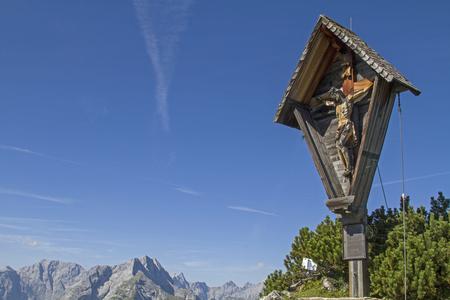The summit cross on the Satteljoch  in the Karwendel mountain range, a popular hut mountain north of the Plumsjoch hut