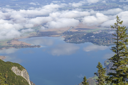 On the ascent to the Herzogstand summit you can enjoy this fantastic view of Lake Kochel at an early morning hour Standard-Bild - 118747776