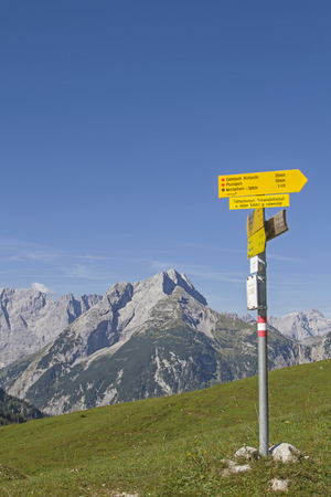 hiking signpost on Plumsjoch with overlooking the Karwendel mountains