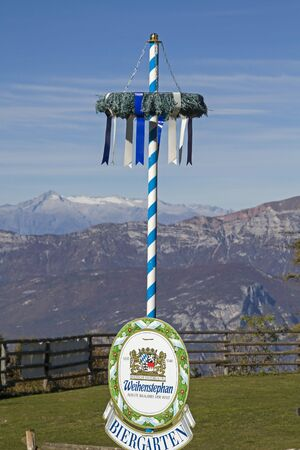 Bavarian symbol in front of the panorama of the Adamello group on the plateau of Folgaria in Trentino