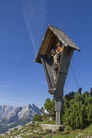 The summit cross on the saddle yoke in the Karwendel mountain range, a popular hut mountain north of the Plumsjoch hut