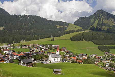 View from the highest point of the Hochbichl to the idyllic village of Berwang in the valley of the same name