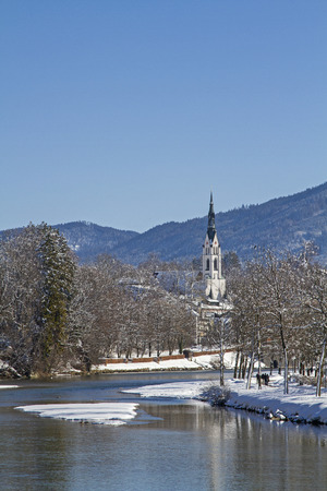 Isar with the parish church of Bad Toelz in winter