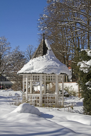 Snow-covered pavilion in the spa park of Bad Toelz