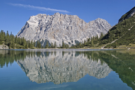The idyllic Seeebensee in the Mieminger mountains in front of the mighty backdrop of the Zugspitze is a popular hiking destination for many climbers