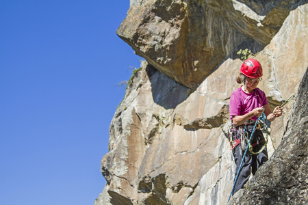 Woman climbs in  climbing area Moos near Soelden - popular with tourists and locals alike Imagens