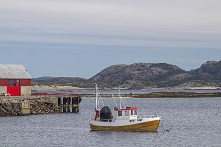 The small fishing port Baroyam on the idyllic Skarafjorden with fishing boat