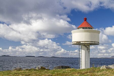 Lighthouse at the harbor entrance at Molnbukt at the Trondheimfjord