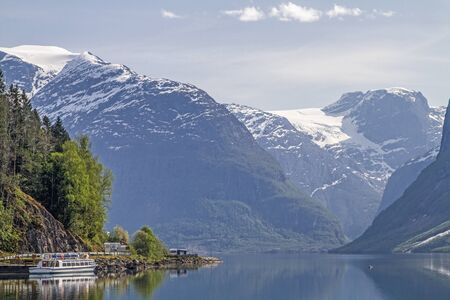 The idyllic Lake Lovatnet in front of the mighty glaciers of the Jostedalsbreen attracts many visitors