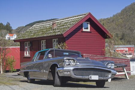 Exciting contrasts - Large car in front of a small hut