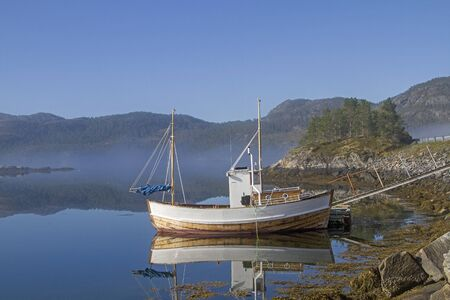 The trawler returned to his anchorage at the small Faerangenfjord in the early morning