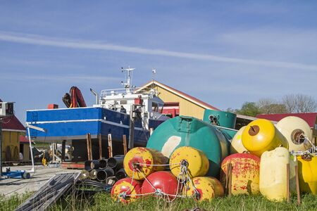 Colorful still life with many floating bodies and buoys in the harbor of Lauvoyvagen Banco de Imagens