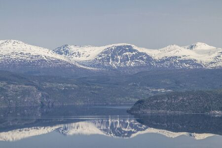 view  on the Innvikfjorden and the still snowy mountains in Hornindal in Norway